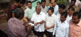 J.R. Lobo hands over relief to families for monsoon damage